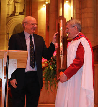 An embossed organ pipe made by Shires is presented to retiring cathedral organist Ian Barber.