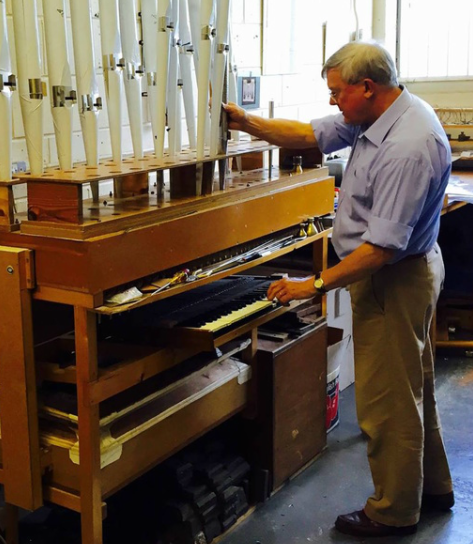 Dr David Frostick voicing organ pipes on his voicing machine.