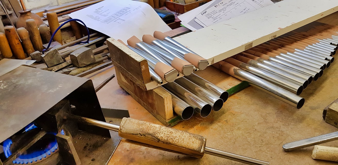 Organ pipes on the bench of George Fowler